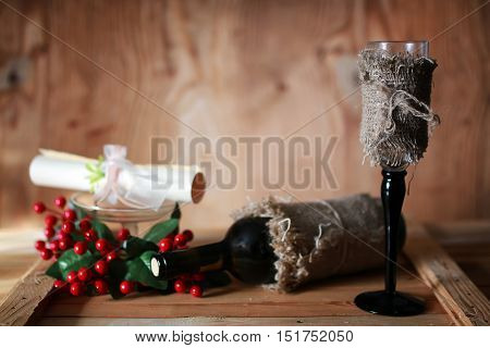 tone wine glasses and invitation wooden background