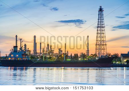 Sunrise over oil refinery river front, industrial landscape background, Bangkok Thailand