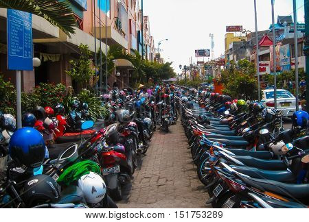 Yogyakarta, Indonesia - January 03, 2012: View of Yogyakarta with its typical hundreds of motorbikes on Yogyakarta, Indonesia. There is nearly 1 million of motorbikes in the whole city.