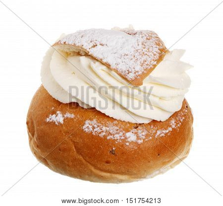 One Swedish Semla also called Shrove Bun fettisdagsbulle consists of light wheat bread with almond paste and whipped cream filling. Serve it with hot milk called hetv