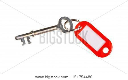 Key with a plastic red key ring isolated on white background