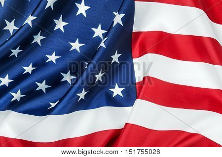 Horizontal American flag made of silk Close-up background