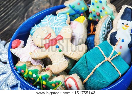 Christmas gingerbread cookies on a plate on the table. Christmas gingerbread