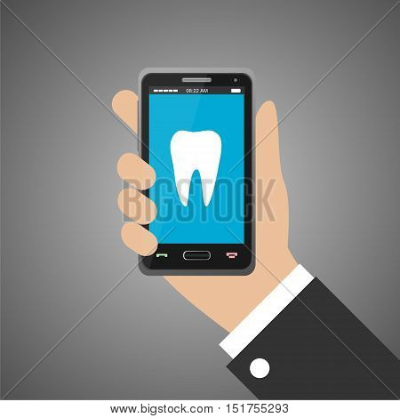 Hand holding smartphone with with dental app on screen