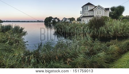 Stunning Dawn Panorama Landscape Image Of Clear Sky Over Calm Lake