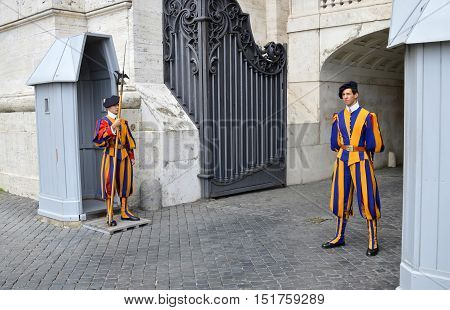 Rome Italy - September 15 2016 : Swiss Guards posted at St. Peter's Basilica Vatican City