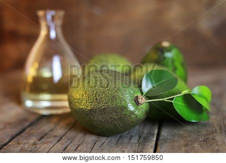 avocado and oil on old wooden background