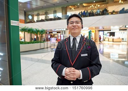 HONG KONG - JANUARY 26, 2016: indoor portrait of a staff at the Elements shopping mall. Elements is a large shopping mall located on 1 Austin Road West, Tsim Sha Tsui, Kowloon, Hong Kong