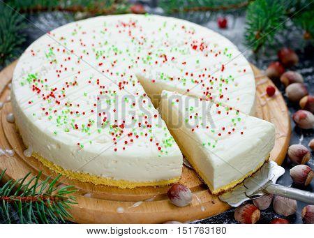 Christmas white chocolate cake with mascarpone. Festive Christmas cheesecake traditional winter cake recipe
