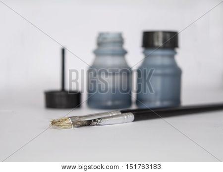 Ink bottles and brushes isolated on the white background