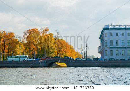 ST PETERSBURG RUSSIA-OCTOBER 3 2016. Autumn landscape of St Petersburg - Upper Swan bridge over the Swan Canal located on the Palace embankment in St Petersburg Russia
