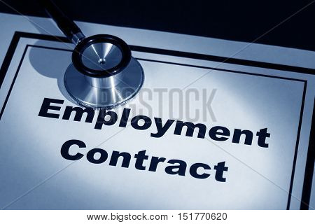 stethoscope and employment contract concept of contract risk.