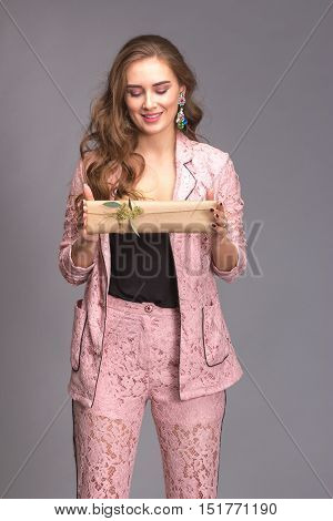 Portrait Of A Happy Woman With Gift Box