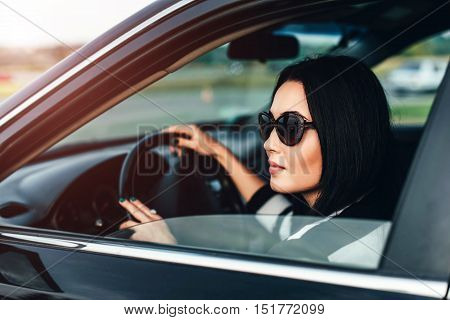 Long Hair Girl Driving Car On The Road