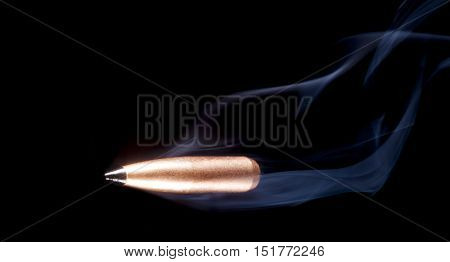 One copper plated bullet with smoke and a polymer tip