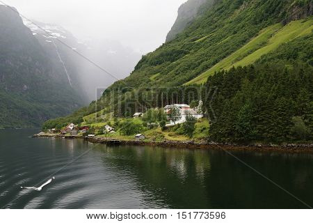 NAEROYFJORD, NORWAY - JULY 3, 2016: This is residential settlement on the banks of Naeroyfjord.