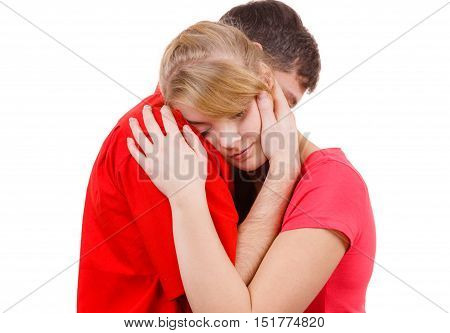 Couple hugging. Woman is sad and being consoled by his partner. Man comforting his girlfriend. Troubled girl and her boyfriend. Studio shot on white
