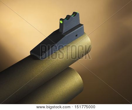 Fiber optic front sight on a gold colored shotgun