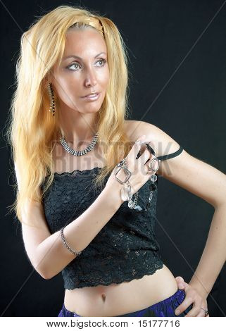 beautiful young blonde woman with long hair and jewellry