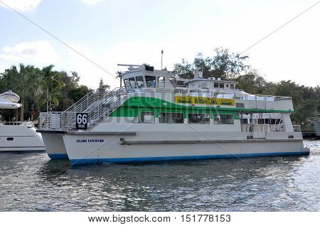 FORT LAUDERDALE, FL, USA - DEC 18, 2012: Water Taxi on New River, Fort Lauderdale, Florida, USA. New River is Intracoastal Waterway to Atlantic Ocean and is home for luxurious yachts.