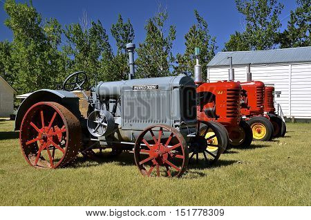 WATFORD CITY, NORTH DAKOTA, June 23, 2016: Vintage McCormick Deering and other tractors are displayed at the Watford City Pioneer Museum which is open and free to the public.