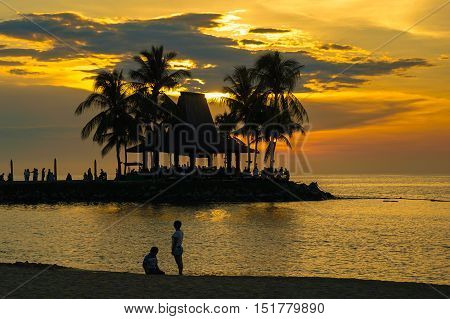 Kota Kinabalu,Sabah-Feb 4,2016:Beautiful tropical sunset with silhouettes of palm trees at Sunset Bar Shangri-La's Tanjung Aru Resort and Spa, Kota Kinabalu on 4th February 2016.