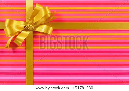 Gift Border Frame With Gold Ribbon Bow And Pink Candy Stripe Background Paper