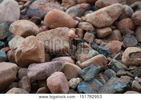 pile of stones near sea bank background texture.