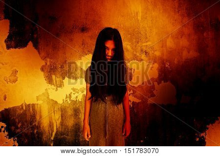 Ghost girl standing in front of the wall,Scary background for halloween concept and book cover ideas