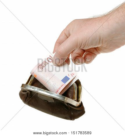 A human hand holding a ten euro bank note in a brown purse isolated on white background.