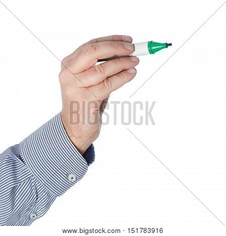Green whiteboard pen in a huan hand isolated on white background.