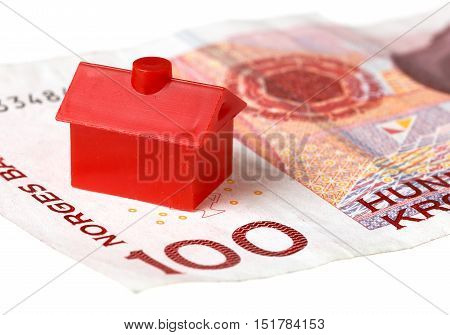 Red litle house on Norwegian one hundred kroner banknote isolated on white background.