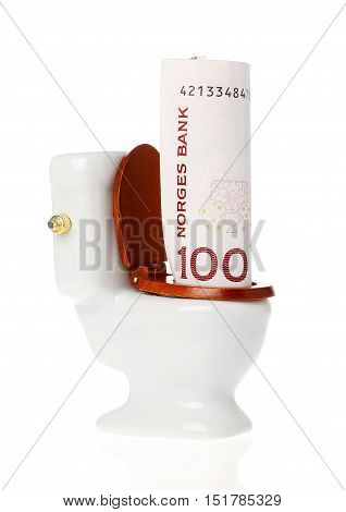 A one hundred kroner Norwegian banknote in the toilet isolated on white background.