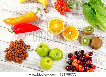 Foods High In Vitamin C On White Wooden Background.
