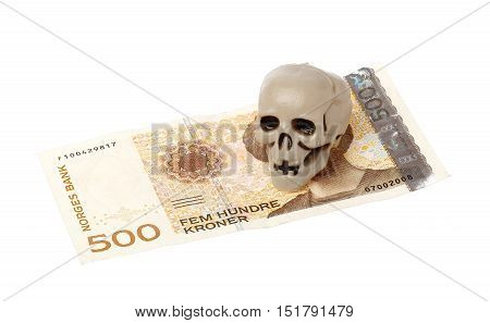 Norwegian 500 kroner bill with a small plastic scull isolated on white background.