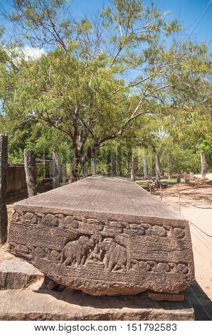 Gal Potha or stone book inscription at ancient city of Polonnaruwa, Sri Lanka. Carvings of two elephants raising their trunks and pouring water onto Goddess Gajalakshmi can be seen at the side of Gal Potha.