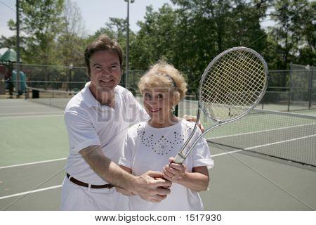 Active Senior With Tennis Pro
