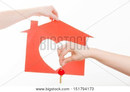 Love romance trade relationship concept. Two people exchanging symbols. Hands holding house symbol giving taking heart key.