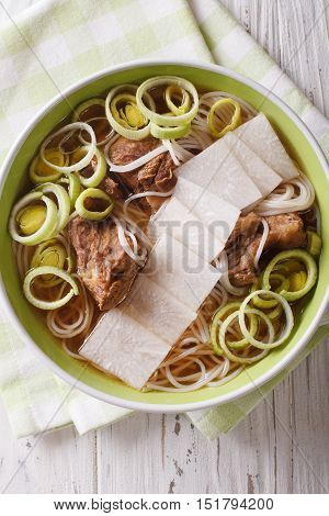 Korean Beef Ribs Soup, Rice Noodles, Leeks And Daikon Close Up. Vertical Top View