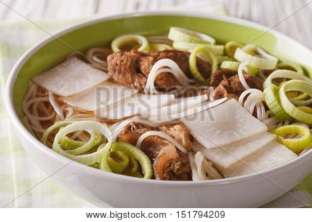 Galbitang Korean Soup With Beef Ribs, Rice Noodles And Daikon Close Up. Horizontal