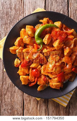 Chicken Jhalfrazi - Indian Cuisine With Pepper And Herbs Close-up. Vertical Top View