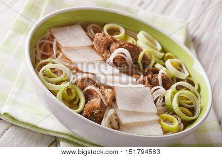 Korean Beef Ribs Soup, Rice Noodles, Leeks And Daikon Close Up. Horizontal