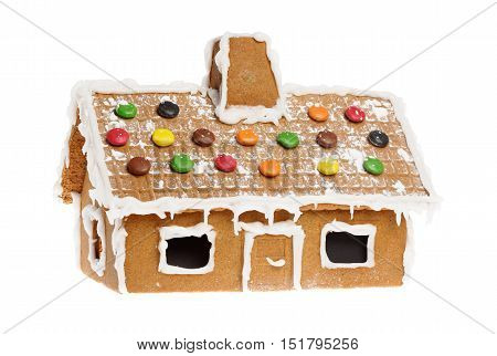 One gingerbread house isolated on white background.