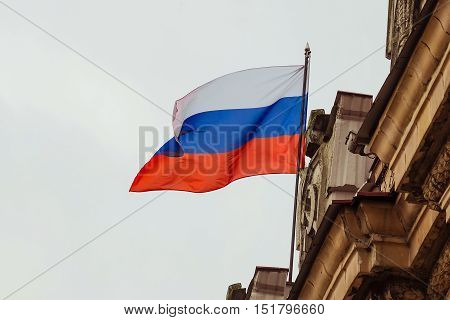 Russian flag waving on the parapet of the administrative building of the Soviet Stalinist architecture