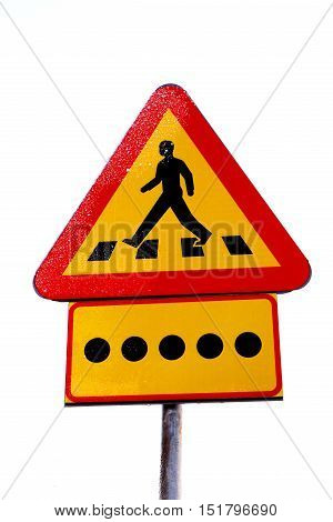 Swedish road sign warning sign pedestrian crosswalk ahead  with a additional panel indicateing blind persons crossing or in the vicinity of the road.