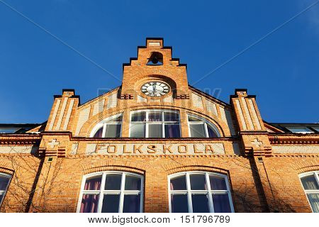 Detail of a school building of brick for the Swedish compulsory school in the previous school system was an elementary school (folkskola).