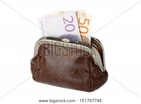 Brown leather purse with two Swedish banknotes in denominations of twenty and fifty crowns isolated on white background.