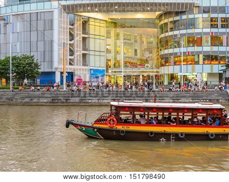 SINGAPORE, REPUBLIC OF SINGAPORE - JANUARY 10, 2014: Historical ships on the Singapore River. Clarke Quay Central disrict, Singapore