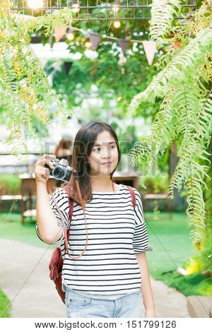 Young Asian Woman Making Photos With Vintage Film Camera