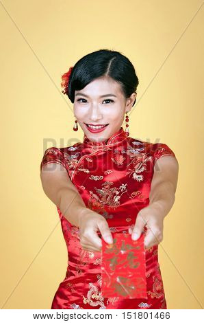 pretty chinese young woman holding red pocket for happy chinese new year